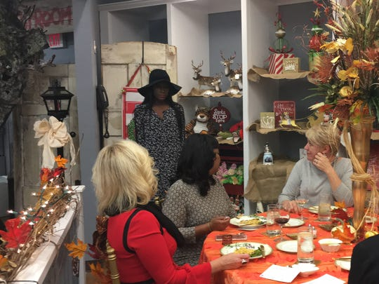 Guests view a fashion show by Imelda's at the Wednesday Wonderment lunch series at King Hardware and Gifts.