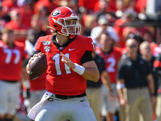 Oct 12, 2019; Athens, GA, USA; Georgia Bulldogs quarterback Jake Fromm (11) looks downfield to pass against the South Carolina Gamecocks during the first quarter at Sanford Stadium. Mandatory Credit: Dale Zanine-USA TODAY Sports