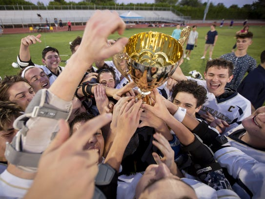 The Oro Valley Wolverines celebrate following their