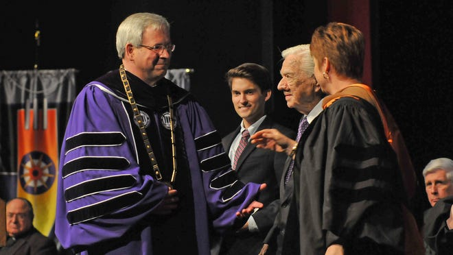 Jim Henderson (left) was robed in academic regalia, a gift from the Student Government Association, and presented with the Presidential Chain during the formal investiture ceremony that marked his installation as the 18th president of Northwestern State University. From left are Henderson, SGA President Garrett Pierce, Jimmy Long, a member of the Board of Supervisors for the University of Louisiana System, and Sandra Woodley, president of the University of Louisiana System.