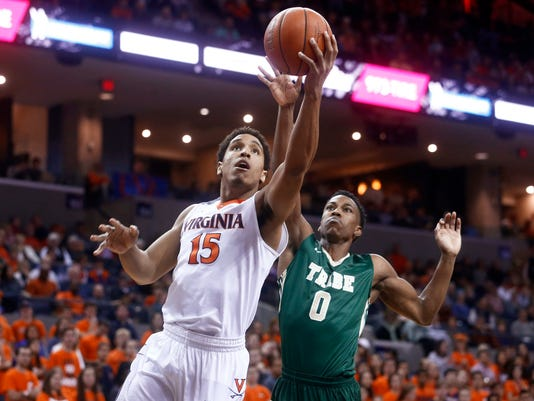 FILE - In this Dec. 5, 2015, file photo, Virginia guard Malcolm Brogdon (15) shoots past William & Mary guard Daniel Dixon during an NCAA college basketball game in Charlottesville, Va. After recent years with the focus locked on one-and-done talent, it's the seniors, guys like No. 1 Michigan State's Denzel Valentine, No. 3 Oklahoma's Buddy Hield and No. 5 Virginia's Brogdon, leading some of the nation's best teams. (AP Photo/Ryan M. Kelly, File)