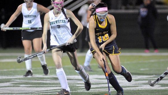 Pelham's Grace Liberatore brings the ball up the field,