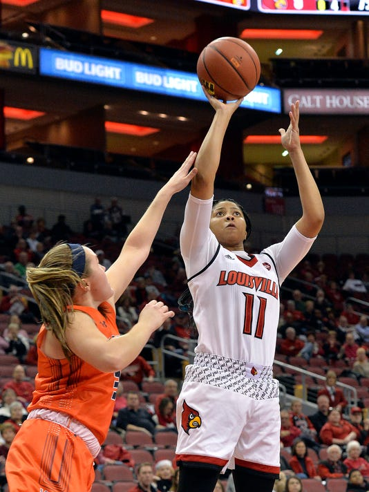 Louisville guard Arica Carter (11) shoots over the defense of Tennessee-Martin guard Kendall Spray (3) during the first half of an NCAA college basketball game, Tuesday, Dec. 5, 2017, in Louisville, Ky. (AP Photo/Timothy D. Easley)