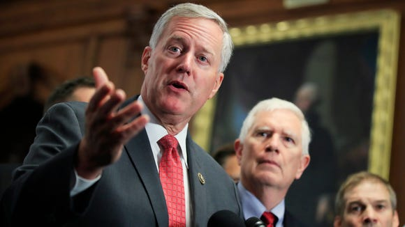 """Eleventh District U.S. Rep. Mark Meadows, R-Buncombe, speaks to reporters on Capitol Hill in Washington, Wednesday, calling on the House to vote on """"clean"""" repeal of the Affordable Care Act."""