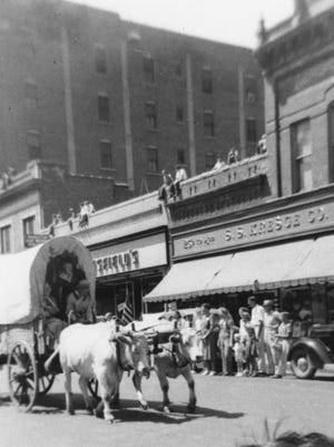 This undated photo shows oxen proceeding north on Phillips Avenue between 10th and 11th streets in front of what is now Zandbroz Variety. The sign above the awning reads 25¢ to $2.00 S.S. Kresge Co. The Kresge Co. had apparently opened a higher-value store farther south on Phillips. Their 5- and 10-cent store was on the corner north of this location.