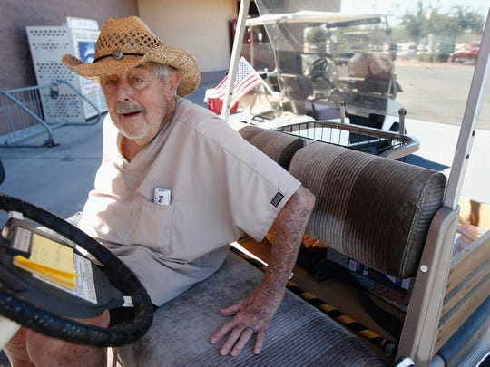 Dr. Charles Thomson, 92, of Sun City gets in his golf cart after talking about his support for President Donald Trump on  Aug. 16, 2017, in Sun City.
