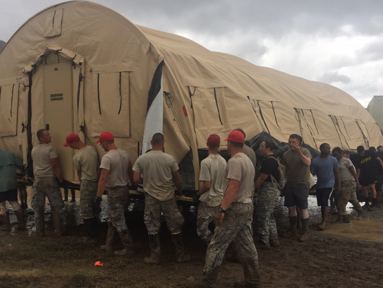 U.S. military personnel move a tent in St. Thomas, U.S. Virgin Islands, as a part of recovery efforts following Hurricane Irma.