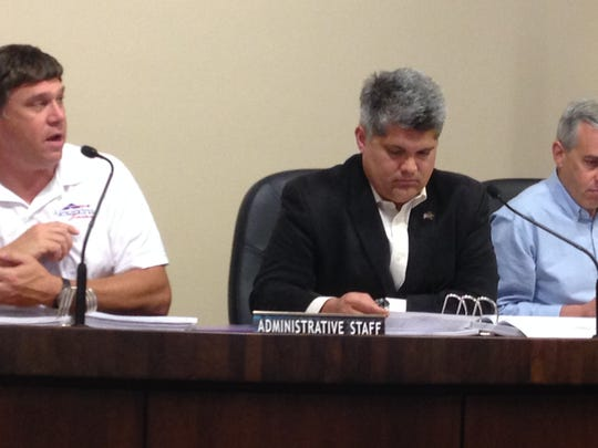 Alexandria Utility Director Michael Marcotte (left) talks about utility projects in the proposed 2015-16 city budget during a City Council committee hearing. Listening to Marcotte are Mayor Jacques Roy (center) and Finance Director David Crutchfield (right).