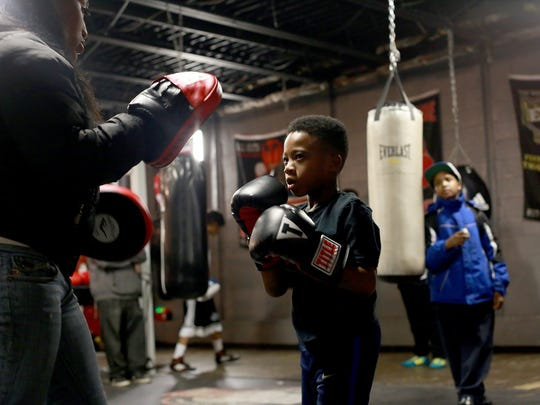"""Amarion """"Dynamite"""" Taylor, 7, of Detroit trains at the Downtown Youth Boxing Gym in Detroit on Dec. 16, 2014."""