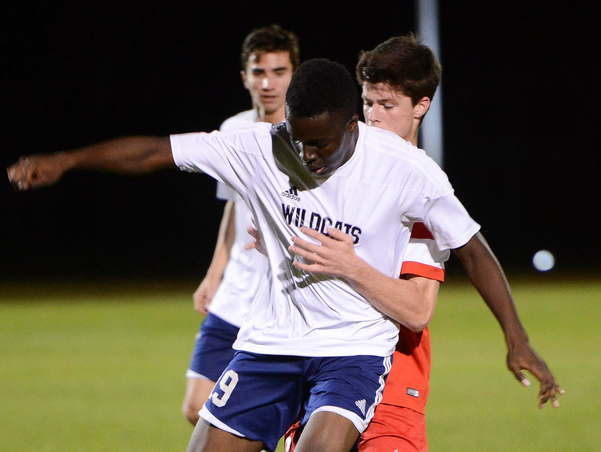 Charlie Wilkinson of Bishop Kenny tries to force West Shore's Amugo Chukwunenye off the ball during Friday's Class 2A state soccer semifinal.