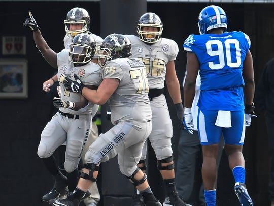 Vanderbilt running back Ralph Webb (7) celebrates his touchdown with teammates against Kentucky during the first half at Vanderbilt Stadium Saturday, Nov. 11, 2017 in Nashville, Tenn.