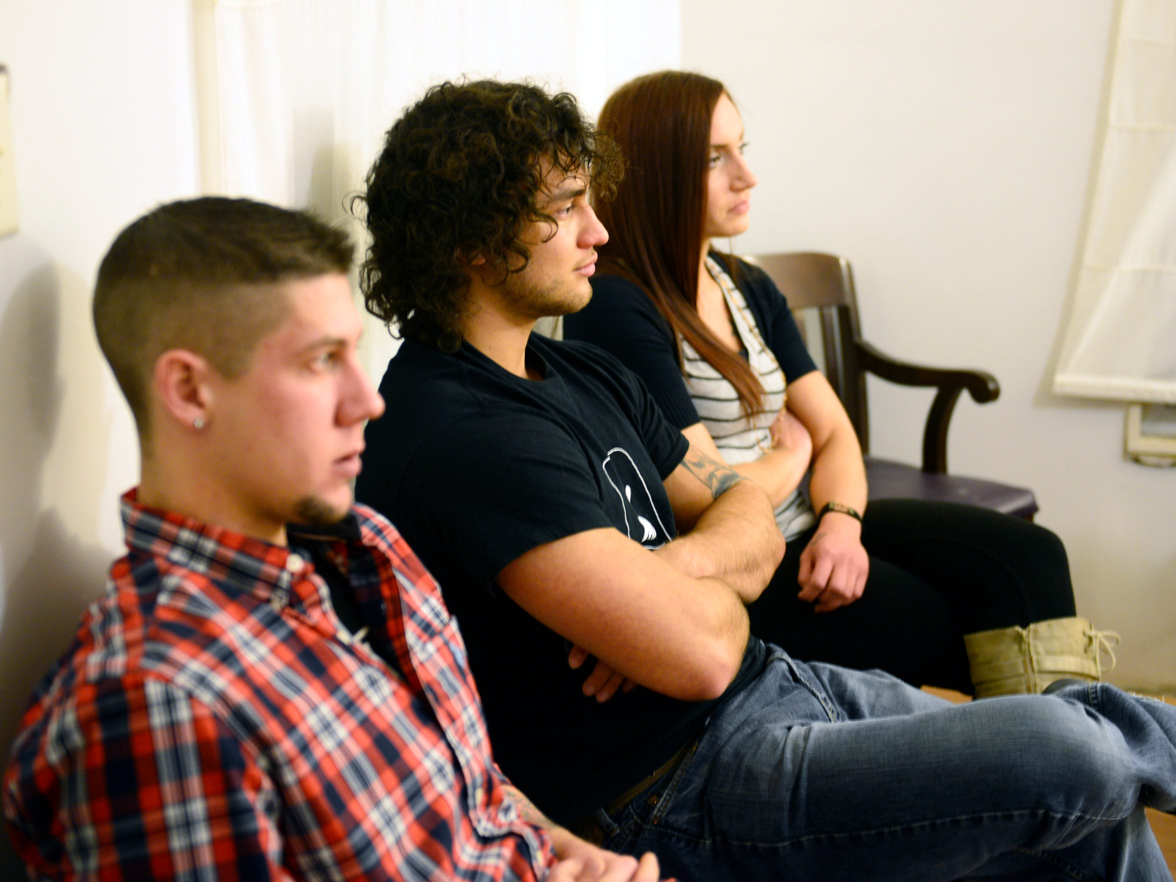 Matt Stookey, 25, of Castalia, from left, Richie Webber, 24, of Clyde, and Kayla Davis, 26, of Bellevue attend a heroin and opiate addiction meeting at Micah House in Fremont.