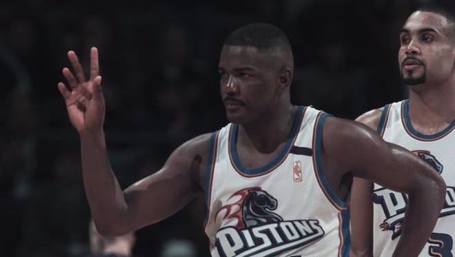 Joe Dumars of Detroit acknowledges the crowd's applause after it was announced that he had scored his 15,000 point in the fourth quarter Friday night against Charlotte at the Palace.