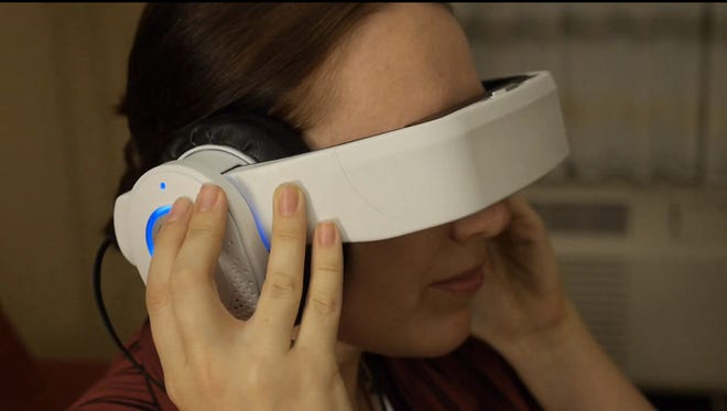 The Avegant Glyph combines a pair of premium over-ear headphones with a flip-down visor that projects images directly onto your retinas.