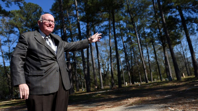 William Carey University President Tommy King points at property the university has bought.