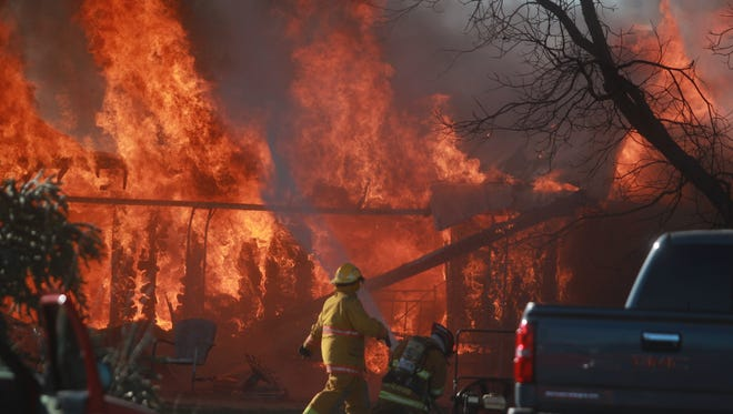Volunteer firefighters from East Concho and Grape Creek battle a residential fire in the 3300 block of Farm to Market Road 2105 in February 2016. Support from the San Angelo Health Foundation helps many volunteer departments in Concho Valley with their equipment needs.