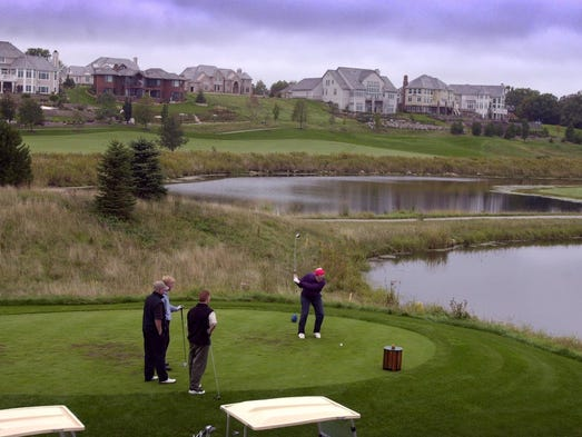 Golfers tee off on the Bristlecone Pines golf course