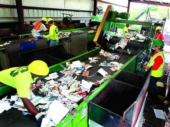 Workers sort recyclables at Marpan. Packaging material