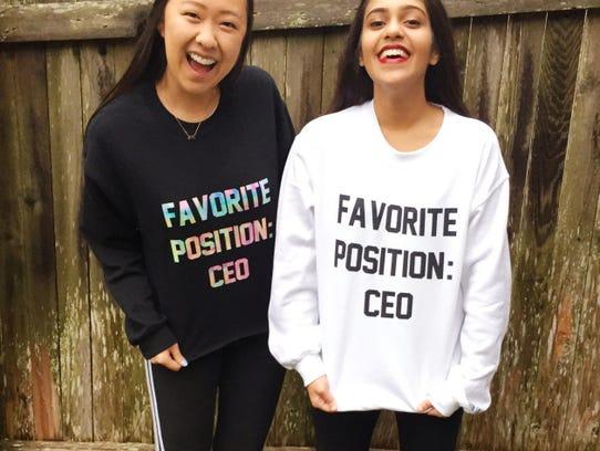 Angela Jin and Nishiki Maredia model their custom designs.