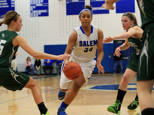 Salem standout senior forward Shara Long (No. 34) cuts through the Waterford Kettering defense on the way to another basket. She scored 27 points for the Rocks.