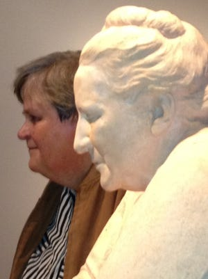 File: A profile of Betty Jean Steinshouer taken with the Jo Davidson sculpture of Gertrude Stein at the National Portrait Gallery in D.C.