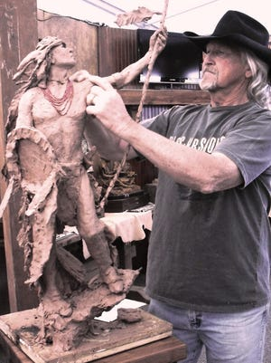 Sculptor Craig Bergsgaard working on one of his sculptures at the Arizona Fine Art Expo. Photo courtesy Arizona Fine Art Expo.