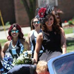 Karolina Ulasevich, Miss Claypool, prepares before the annual parade in downtown Mansfield on Sunday.