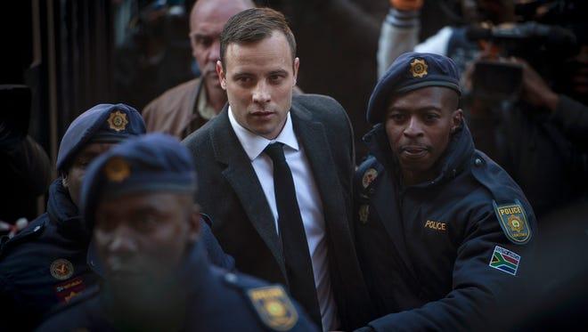 Oscar Pistorius arrives at court Wednesday in Pretoria.