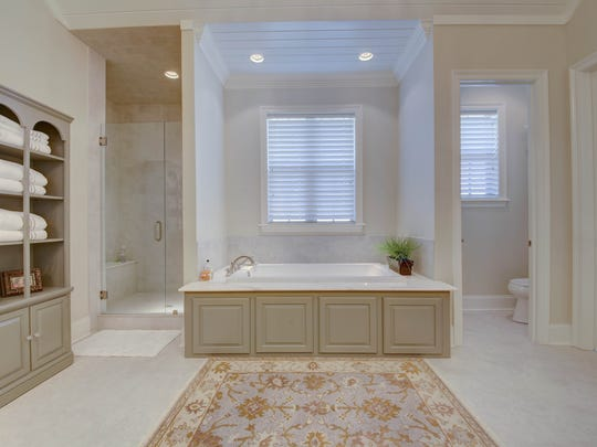 The master bath has a soothing, spa-like atmosphere.