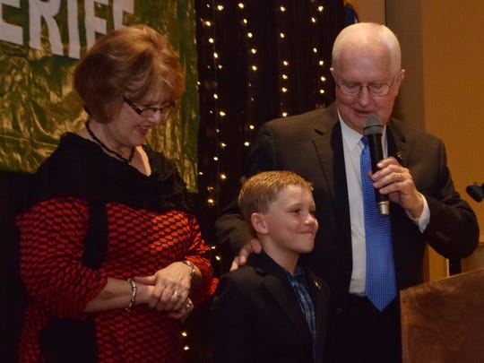 Rapides Parish Sheriff William Earl Hilton was re-elected to a sixth term on Saturday. He is shown on stage Saturday night with his wife, Billie Faye, and grandson, Slade Hilton.