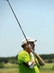 Steve Gandy, from Van, watches his tee shot on the