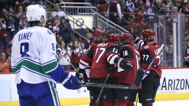 Arizona Coyotes players celebrate a goal by center Alexander Burmistrov (91) during the second period of a NHL game against the Vancouver Canucks at Gila River Arena on April 6, 2017.