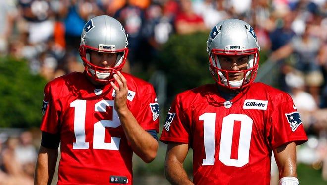 New England Patriots quarterback Tom Brady (12), quarterback Jimmy Garoppolo (10) and quarterback Jacoby Brissett (7) during training camp at Gillette Stadium.
