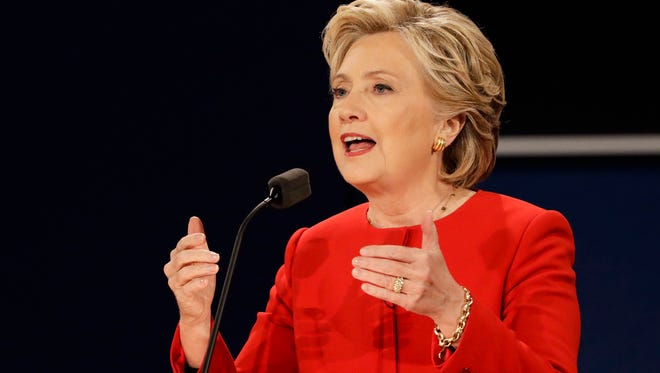 In this Sept. 26, 2016, photo, Democratic presidential candidate Hillary Clinton answers a question during the presidential debate with Republican presidential candidate Donald Trump.(AP Photo/David Goldman)