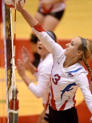 Union County's Madison Rosenberger hits the ball against Richmond Tuesday, Sept. 6, 2016, during a volleyball match in the Tiernan Center at Richmond.