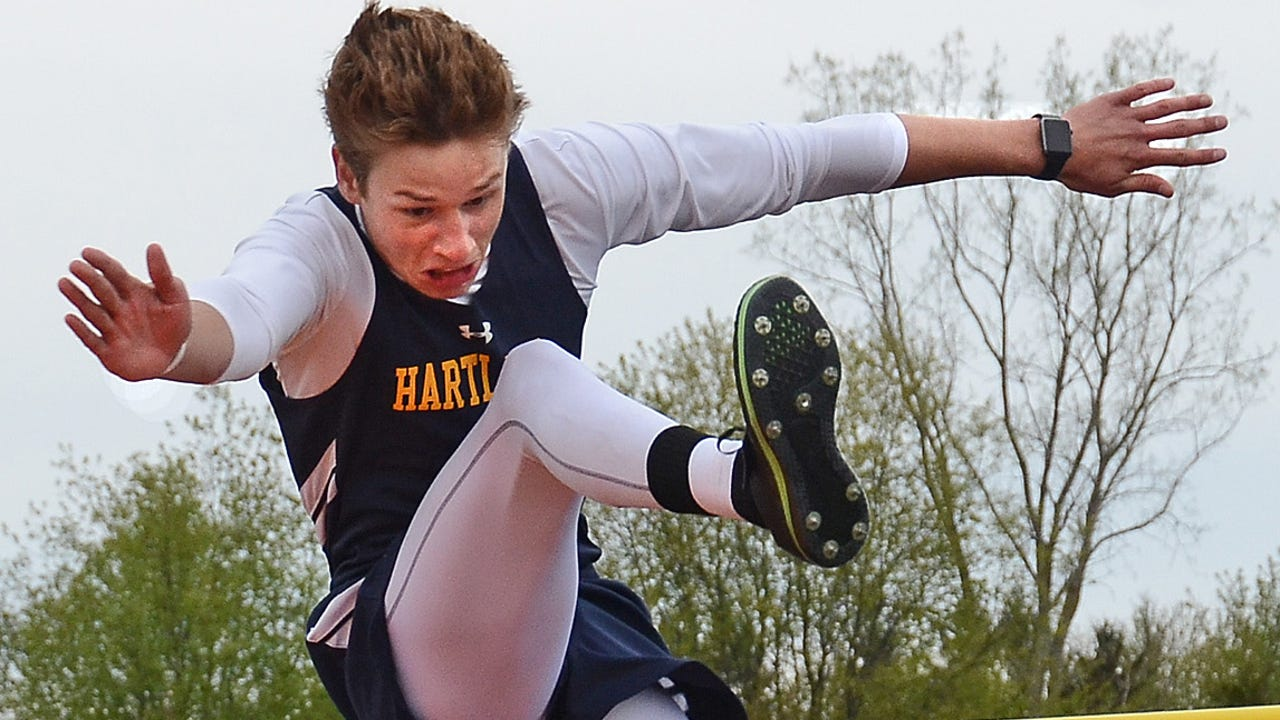 Hartland's Tyler Thompson took second in the pole vault at 12 feet, then won the high jump with a leap of 6 feet, 2 inches. He talks about being able to do both events this season after a hand injury prevented him from vaulting last year.