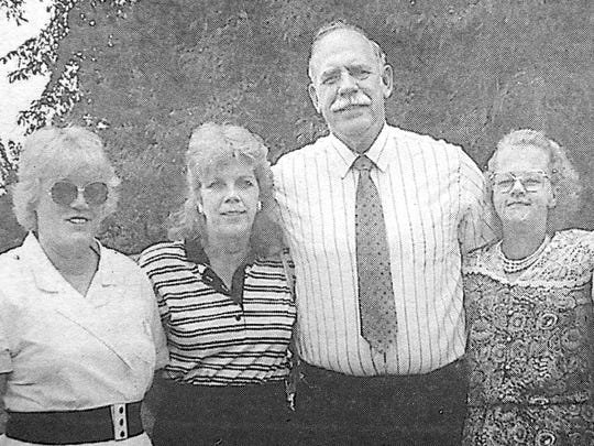 Joan, at left, Judy, L.B, Jane and Juanita Grant after their mother's funeral in June 1997.