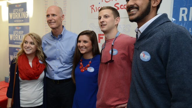 Gov. Rick Scott meets with supporters at the Republican headquarters building off North Ninth Ave. on Election Day Tuesday at about 4:30 p.m.