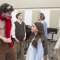 "In rehearsals for the Fowlerville Community Theatre's ""The Lion, the Witch and the Wardrobe,"" are from left, Nic Foley as Mr. Tumnus, Micah Johnson as Edmund, Kaitlyn Campos as Lucy, Melanie Matticks as Susan and Justin Poole as Peter."