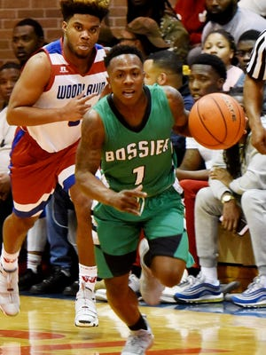 Bossier's Jacoby Decker drives to the bucket for two of his 37 points against LHSAA No. 1 Woodlawn Tuesday night in the Woodlawn gym.