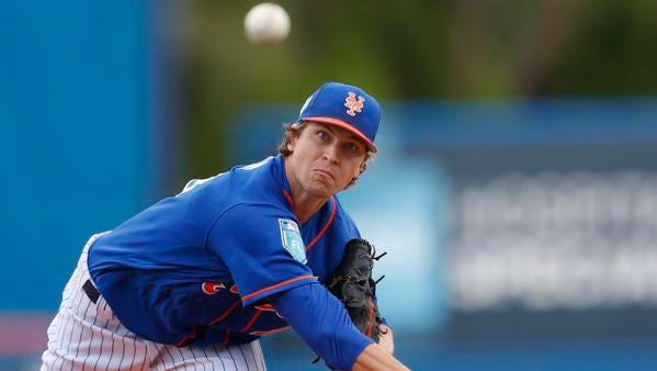 New York Mets starting pitcher Jacob deGrom (48) warms up before the first inning of a spring training baseball game against the Houston Astros Sunday, March 11, 2018, in Port St. Lucie, Fla. (AP Photo/John Bazemore)
