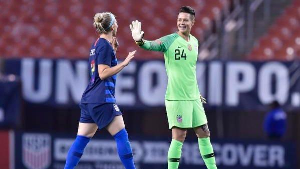 United States goalkeeper  Ashlyn Harris (24) and midfielder Julie Ertz celebrate a win over China PR in an international friendly women's soccer match at FirstEnergy Stadium.