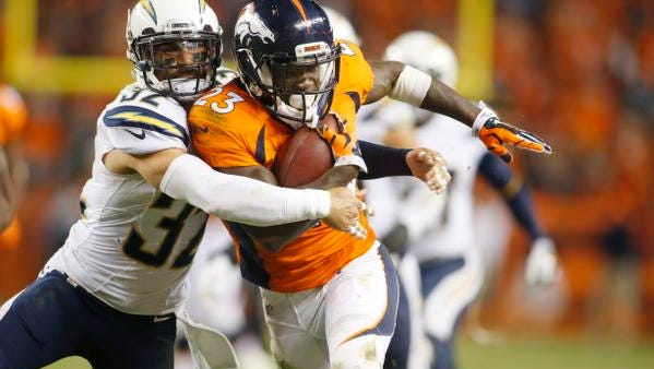 Denver Broncos running back Ronnie Hillman (23) is tackled by San Diego Chargers free safety Eric Weddle (32) during the second half Oct. 23. The Broncos won 35-21.