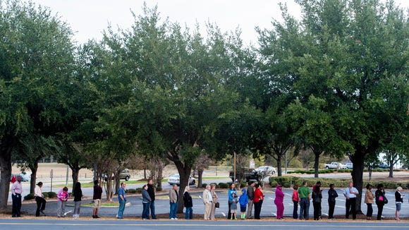 Voters line up to wait for polls to open at Vaughn
