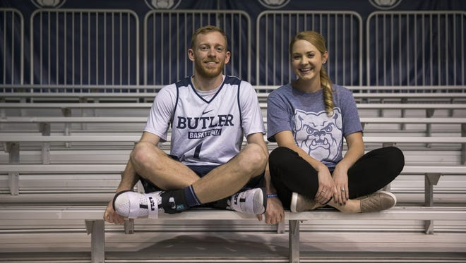 Tyler Lewis, Butler University basketball player, with fiancee Ali Burgiss, Indianapolis, before the day's practice at Hinkle Fieldhouse, Monday, March 20, 2017. The men's team faces North Carolina in their Sweet Sixteen matchup.
