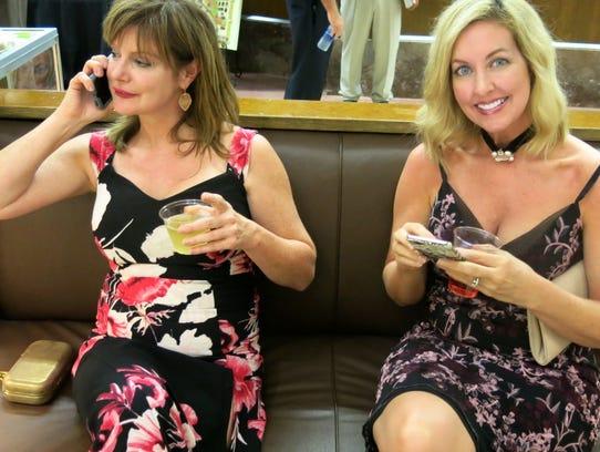 Lidgette Burda and Robin Flatt at Glitz & Grits.