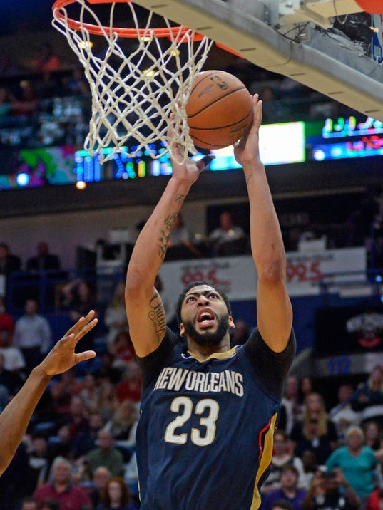 New Orleans Pelicans forward Anthony Davis shoots during the final moments of the team's NBA basketball game against Miami Heat in New Orleans on Friday, Feb. 23, 2018. (AP Photo/Veronica Dominach)