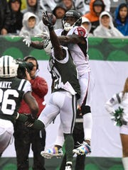 Atlanta Falcons wide receiver Julio Jones (11) cannot complete a touchdown pass with coverage by New York Jets cornerback Morris Claiborne (21) in the first quarter. The New York Jets lead the Atlanta Falcons 17-13 at the half on Sunday, October 29, 2017 in East Rutherford, NJ.