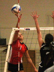 John Glenn's Erin Parrinello goes high for a tip during Tuesday's match against Allen Park.