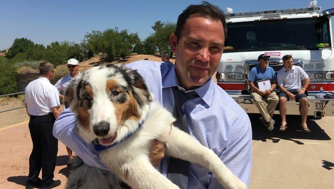 Duke, a 6-month-old Australian shepherd, and his owner, Jim Palecek, of Scottsdale.